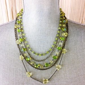 Bib necklace of rope chains and green beads